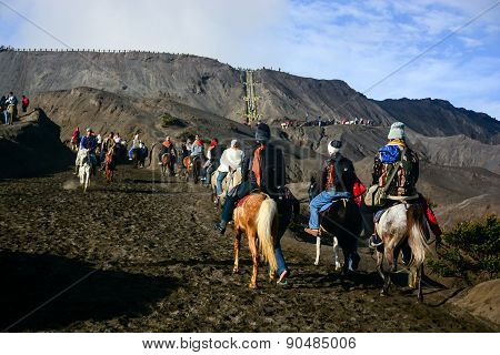 Tourists Ride The Horses To The Crater Of Mount Bromo
