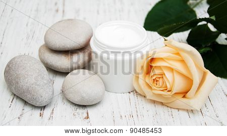Cosmetic Cream With Spa Stones And Rose