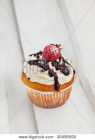 Cream, chocolat? and strawberry cupcake