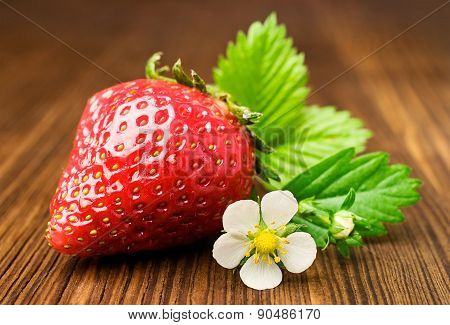 Ripe Strawberry With Leaf And Flowers