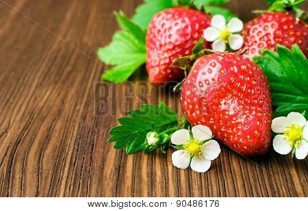 Wooden Background With Strawberries