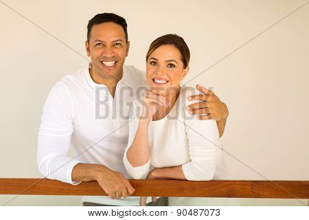 portrait of middle aged couple inside their new house