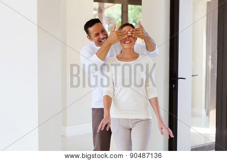 portrait of man surprise his wife with new house