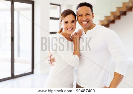 beautiful mid age couple portrait in their new house