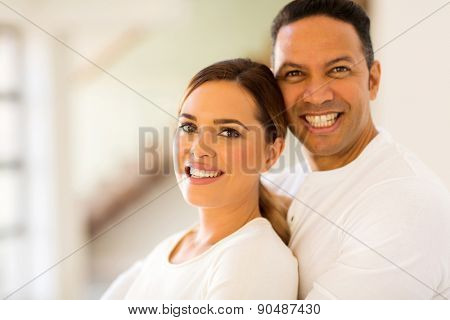 portrait of smiling mid age couple looking at the camera