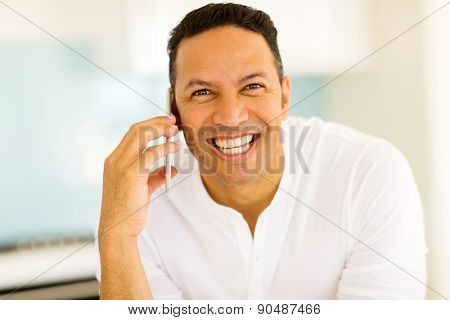 good looking middle aged man talking on mobile phone