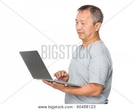 Old man use of laptop computer