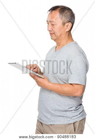 Mature man use of digital tablet