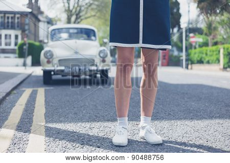 Woman Standing In Stret With Classic Car