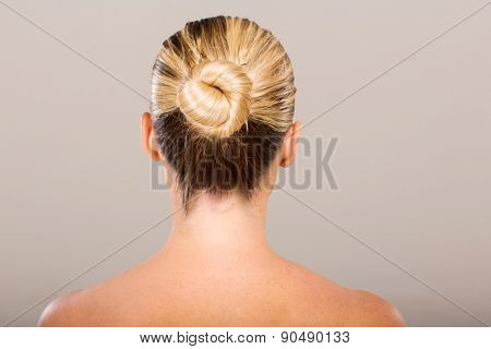 rear view of young woman with hair bun