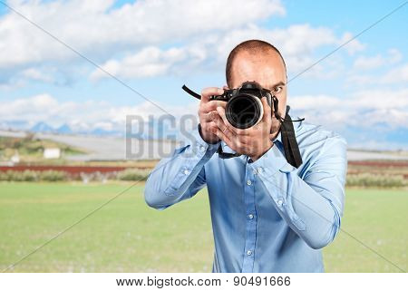 portrait of photographer and landscape background