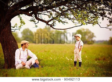 Farmer Family Having Fun Under An Old Tree, Spring Countryside