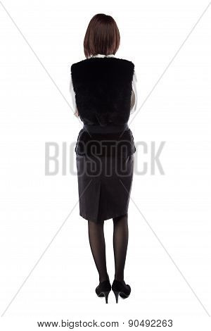 Woman with arms crossed turned back