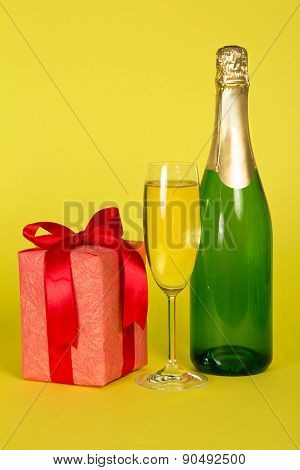 Champagne with glass and gift