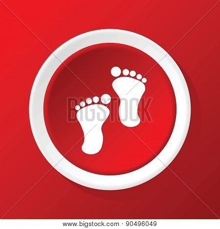 Footprint icon on red