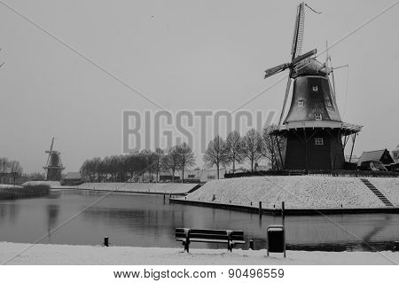 two historical Windmills in snow,