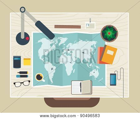 Top view of desk background with map, digital devices, office objects, books and documents.