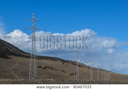 Landscape With Line Of  Electricity Towers