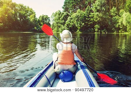 Woman kayaking on river