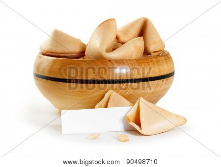 Chinese fortune cookie with blank paper strip isolated on white background