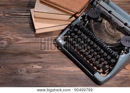 Old retro typewriter on table close-up