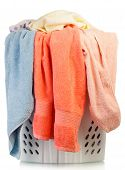 stock photo of dirty-laundry  - Pile of dirty laundry in a washing basket on a white background - JPG