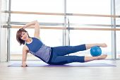 foto of stability  - pilates woman stability ball gym fitness yoga exercises girl - JPG