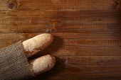 stock photo of baguette  - Fresh loafs of baguette on wooden table top copyspace horizontal picture - JPG