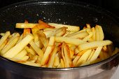 picture of gold panning  - Roasted potato chips in a metal frying pan close - JPG