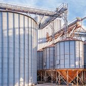 stock photo of silos  - Storage facility cereals and production of biogas - JPG