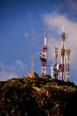 stock photo of antenna  - White and Red Antennas on the Top of a Hill - JPG