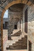stock photo of barn house  - old barn house built of bricks in China - JPG