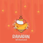 foto of ramadan mubarak  - Beautiful arabic lantern decorated with flowers and hanging golden stars for Islamic holy month of prayers - JPG