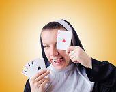 image of nun  - Nun in the gambling concept - JPG