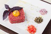 stock photo of yolk  - tartar of beef with egg yolk - JPG