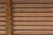 foto of log fence  - timbered wooden wall made from logs as background - JPG