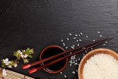 pic of soy sauce  - Japanese sushi chopsticks over soy sauce bowl - JPG