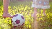 foto of barefoot  - barefoot little girls playing football at the meadow - JPG