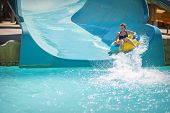 pic of inflatable slide  - beautiful girl pulls off the slides at the water park - JPG