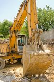 picture of excavator  - The excavator working on a construction site - JPG