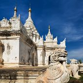 stock photo of guardian  - White Pagoda at Inwa ancient city with lions guardian statues - JPG