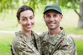 image of reunited  - Army parents reunited on a sunny day - JPG