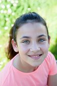 image of  preteen girls  - Happy casual preteen girl looking at camera outside - JPG