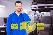 picture of auto repair shop  - Smiling male mechanic using his mobile phone against auto repair shop - JPG