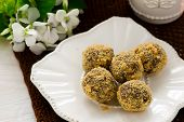 stock photo of truffle  - candies chocolate truffles  on white plate - JPG