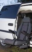 foto of physically handicapped  - Seat that electrically comes out for physically disabled to ride in a vehicle - JPG