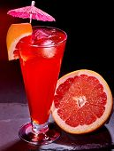 picture of cocktail  - Grapefruit cocktail with umbrella  in highball glass  - JPG