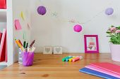 pic of little school girl  - Color school accessories on the desk of little girl - JPG