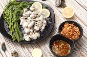 image of oyster shell  - Oyster seafood lemon fresh asia fried shallots sauce mussel asia appetizer luxury - JPG