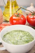 image of pesto sauce  - sauce of pesto near a tomato olive oil and eggs in a studi - JPG